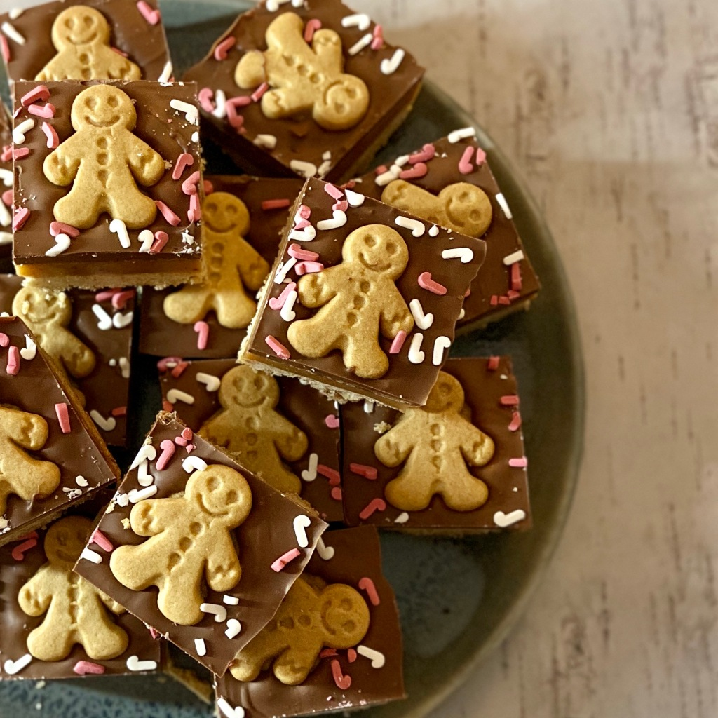 Gingerbread men on a layer of spiced shortbread and a ginger caramel. Topped with a ginger chocolate.